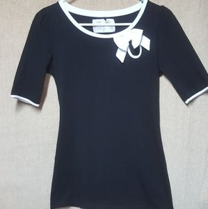 Black shirt with white bow